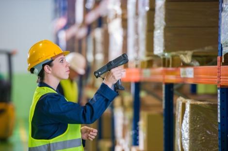 Warehouse Employee Scanning Boxes
