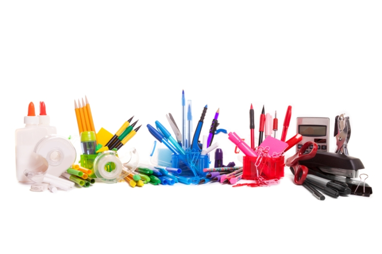 A collection of school supplies organized by color.